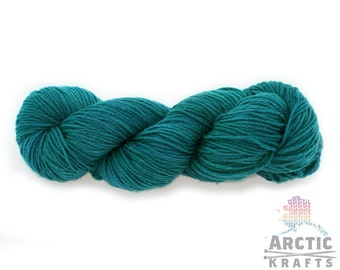 Teal hand dyed worsted weight superwash merino wool yarn 220 yards