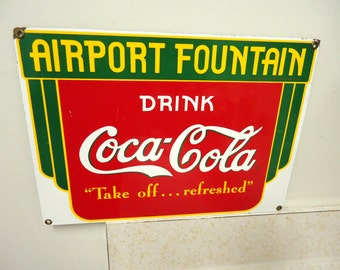 vintage coke,coca cola porcelain sign,soda pop advertising,airport fountain,drink coke