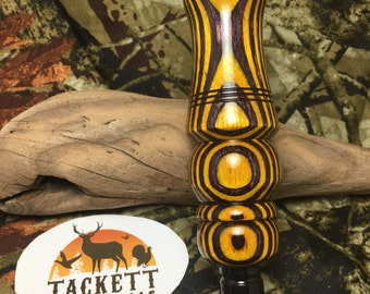 Purple and yellow laminate double reed duck call.