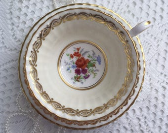 Reserved Paragon China Tea Cup and Saucer, Cream with Hand Painted Floral Centres and Gold Trim, 1949-52