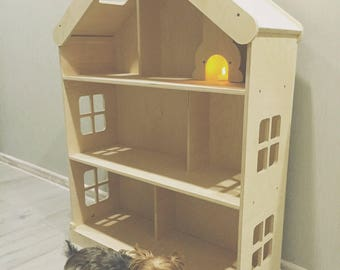 Amazing dolls house with a fireplace.