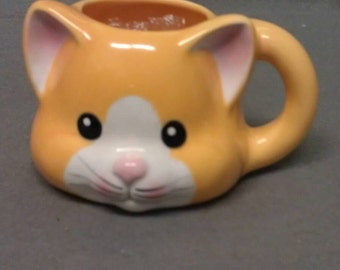 Off Yellow Cat with Pink Ears and Nose White Face and Black Eyes Cat Mug