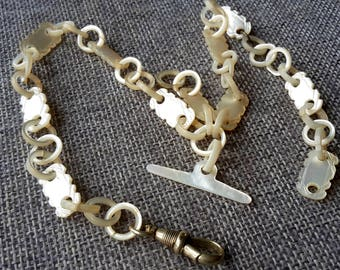 This is a very rare Antique Scrimshaw Mother of pearl pocket watch chain ( one link broken )