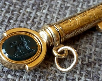 This is very rare antique stunning high quality Georgian / victorian 15ct gold bramah lock key with a double intaglio spinning seal
