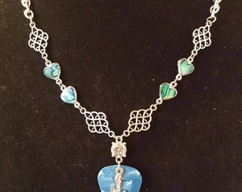 Turquoise blue guitar pick necklace