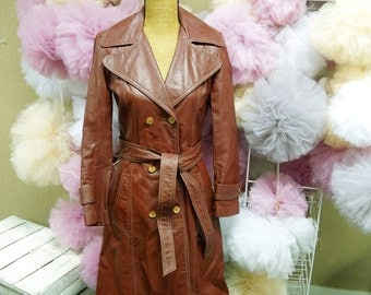 VINTAGE: Carla New York  1970s Brown/Maroon Leather Trench Coat/ 1970s Leather Jacket /Belted Ladies Leather Coat / Size 7.