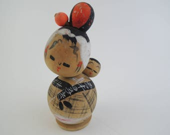 Vintage kokeshi doll, baby sitting