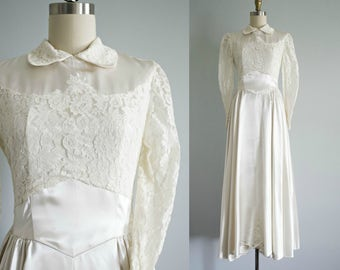 1940s wedding dress . vintage 40s off white satin and lace New Look wedding gown . tea length . full skirt . long sleeves . small