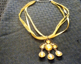 gold colored glass chandelier pendan and ribbon