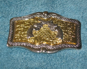 Vintage Beautiful Gold & Silver Belt Buckle With Crossed 3-D Guns In Unused Condition.
