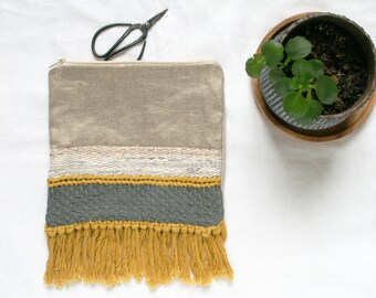 Woven and hand stitched bag