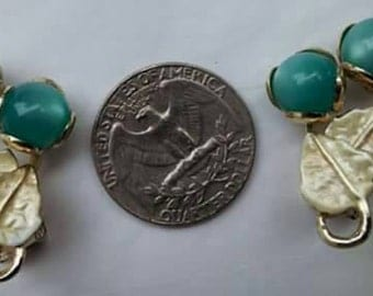 Vintage mid century moonglow thermoset clip on earrings with pearlized gold leaves