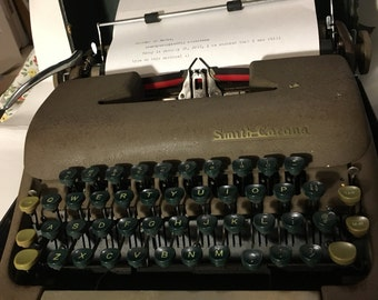 RESERVED for Jess!...1940s Smith and Corona Sterling Typewriter .... for parts. Carriage clip is broken
