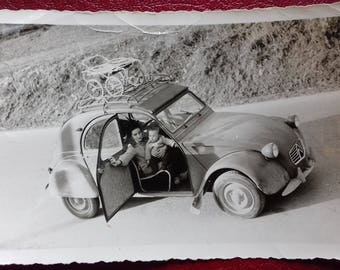 Vintage photo of mother and her baby in Citroen 2CV/ Citroen 2CV-Deux chevaux/Two steam horses/Legendary 2CV