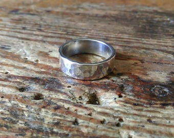 Heavy silver ring hammered structure