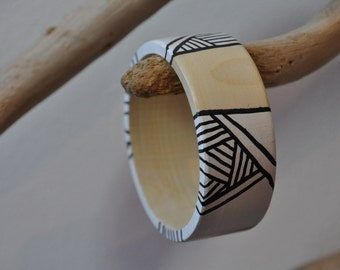 Beauty on the arm of the beholder: One off handpainted wooden bracelets