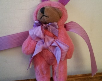 Bear in pink bunny clothes
