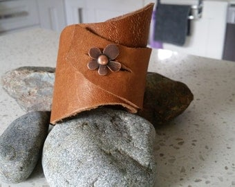 wide leather cuff bracelet with copper flower button