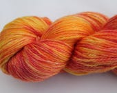 A Luxuriously soft Hand dyed 4ply Yarn on a Super Wash Merino, Tencel base in the Orange Tulips colourway. A blend of yellows and oranges.