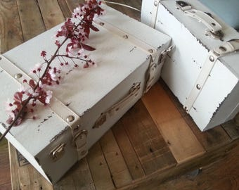 White wooden antique suitcase with leather details.