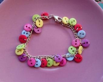 Multicoloured button bracelets.