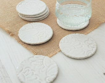 Handmade ceramic coasters, vintage lace, set of four white coasters, pottery coasters, handmade gift, housewarming gift, drinks coasters