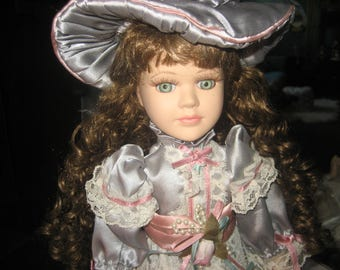 Green Eyed Genuine Porcelain Doll with Stand