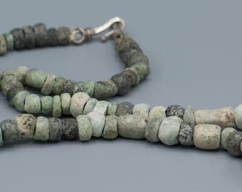"""86 Pre-Columbian Green Stone and Jade Beads with a Silver Clasp. 7-13mm 16"""" Strand"""