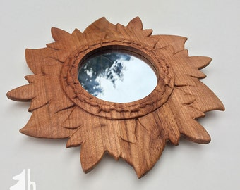 Round frame from butternut wood, with mirror.