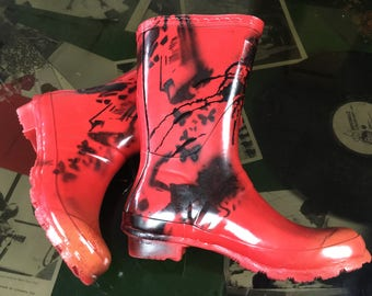 Humanitee Fashion red and black Graffiti wellies. One pair available. Women's Size 5. Reading Glastonbury