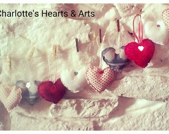 Small hand sewn material hearts , perfect for any Christmas tree