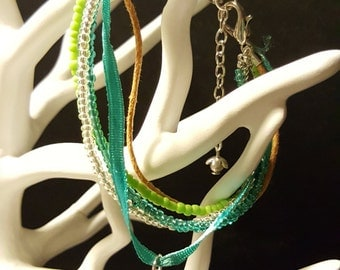 Green Feather bracelet - bracelet MultiRow - beads, cords and leaf charm