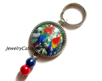 Keychain, cabochon bird parrot, pearl red blue, cabochon, jewelry bag