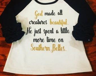 God Made All Creatures Beautiful. He Just Spent A Little More Time On Southern Belles. Toddler, baby, infant t-shirt. Ruffle raglan south.