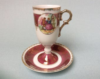 Vintage footed mocca cup and saucer with image of a courting couple, Trêves porcelain, French cup and saucer