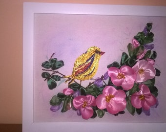 Embroidery with satin ribbons.Bird perched on a branch of roses.Framed embroidery.Gift.