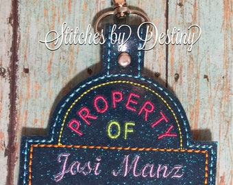 Property of luggage tag, bag tag, oversized keyfob