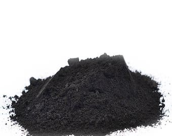 Natural charcoal tooth powder whitens teeth naturally