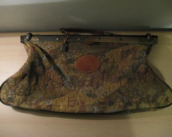 Old French tapestry medical bag with brass buckle and leather accenten..Years  30