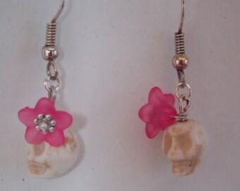 Skull earrings and flowers