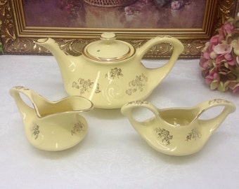 Pearl hand decorated Art Deco teapot with cream and sugar.