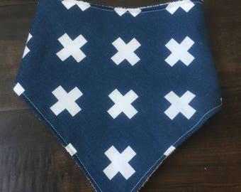 Navy blue bib with white x's
