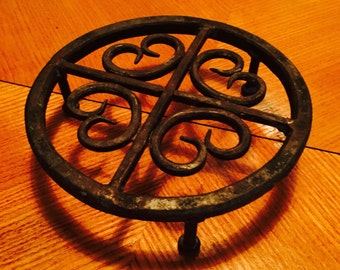 Swedish cast iron trivet from 1960s with patina