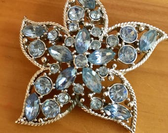 Vintage Star Fire Brooch by Sarah Coventry.  Silver with sparklong baby blue rhinestones in the shape of a Starfish.