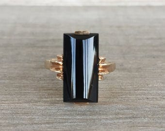 Curved top black onyx vintage ring