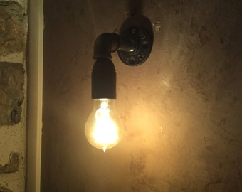 Wall light with black cast iron fittings