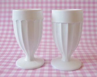 Two Milk Glass Footed Vases