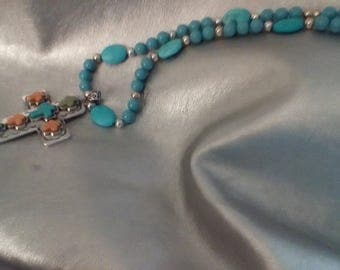Turquoise, blue, and pink crosses on silver with silver clasp and bail
