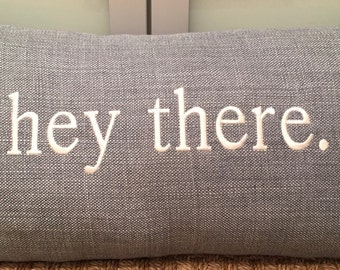 "12x24 blue linen pillow with ""hey there"" embroidery"