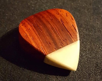 Wooden plectrum with bone tip